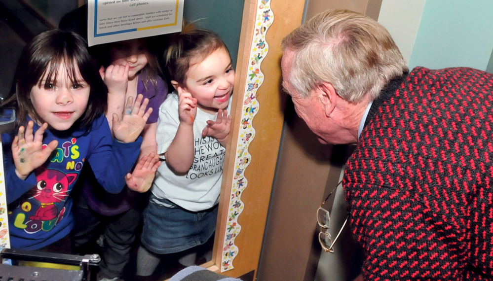 FUN VISIT: U.S. Sen. Angus King interacts with children outside a classroom door in a classroom at Educare Central Maine during a tour of the Waterville facility on Wednesday, Jan. 22, 2014.