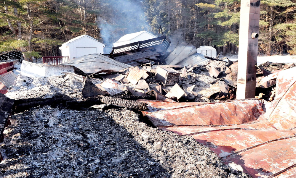 GONE: Smoke rises from the rubble of the former Professional River Runners base camp in The Forks on Thursday, Jan. 23, 2014. Firefighters responded Wednesday night and found the building engulfed in flames. Acting fire chief Charles Napolitano said the fire is not suspicious and he could not determine a cause. The building is owned by Ed Beauchamp of West Forks.