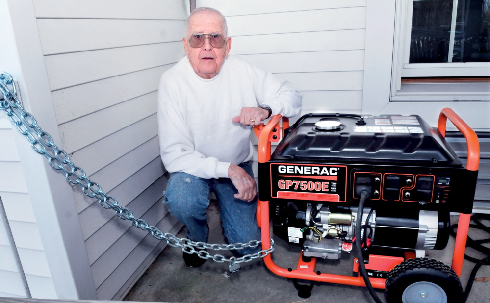 SECURE: Dick Thorndike, manager of the Hartland Manor, beside a new generator that is chained to the building on Thursday, Jan. 23, 2014, after it was discovered that thieves stole their previous generator last weekend.
