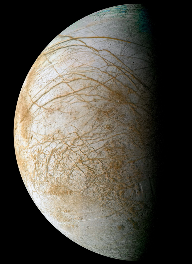 THICK ICE: Jupiter's moon Europa is covered in ice 50 to 100 miles thick. This view from the Galileo spacecraft combines images taken in 1998 and 1995.