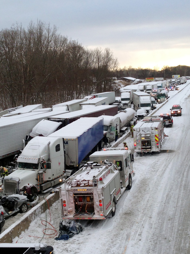 Emergency crews work at the scene of a massive pileup involving more than 40 vehicles, many of them semitrailers, along Interstate 94 in Indiana. AP Photo