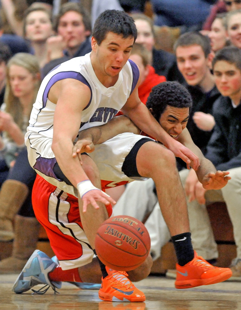 Staff photo by Michael G. Seamans Waterville Senior High School's Christopher Hale, 21, fights for the loose ball with Camden Hills High School's Colin Morse, 23, in the fourth quarter in Waterville on Friday. Waterville defeated Camden Hills 62-56.