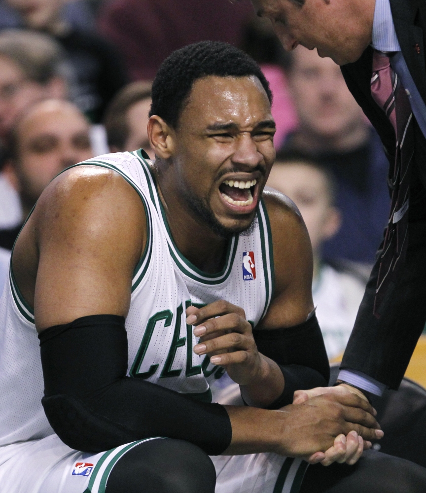 Boston Celtics center Jared Sullinger wincesafter injuring a finger during the first quarter of an NBA basketball game against the Oklahoma City Thunder in Boston, Friday, Jan. 24, 2014. Sullinger returned to play later in the quarter, with his fingers taped.