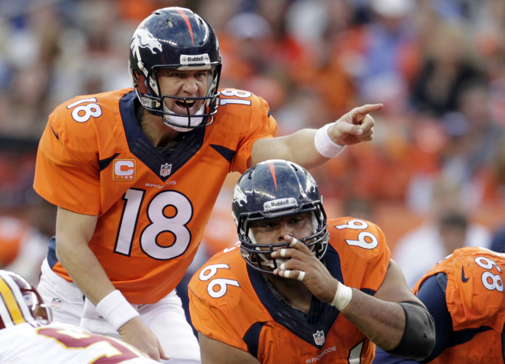 FILE - In this Oct. 27, 2013, file photo, Denver Broncos quarterback Peyton Manning (18) calls an audible at the line of scrimmage in the fourth quarter of an NFL football game against the Washington Redskins in Denver. The sound of Manning barking ìOmaha! Omaha!î is picked up by a tiny microphone in an offensive linemanís pads so it can be broadcast to the world. In an age of enormous high-definition televisions and games streamed to tablets and smartphones, audio seems almost quaint. Yet TV executives have made it a major focus in recent years, for the exact reason so many people are fascinated by the Broncos quarterbackís audibles. (AP Photo/Joe Mahoney, File)