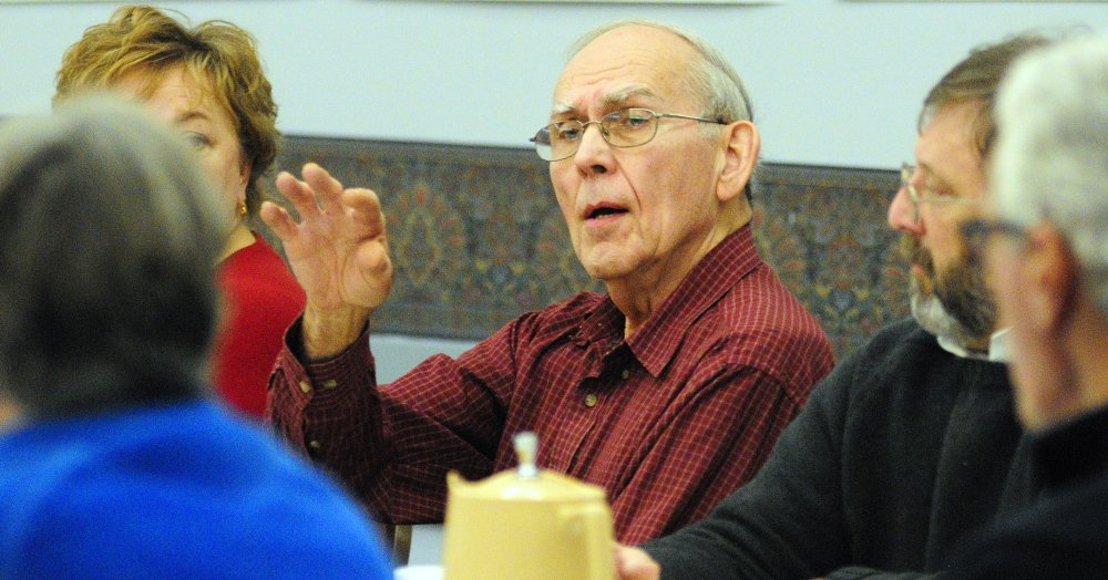 A YEAR IN FOCUS: City Councilor Cecil Munson speaks during the Augusta City Council goal-setting meeting Saturday in the Augusta Civic Center.