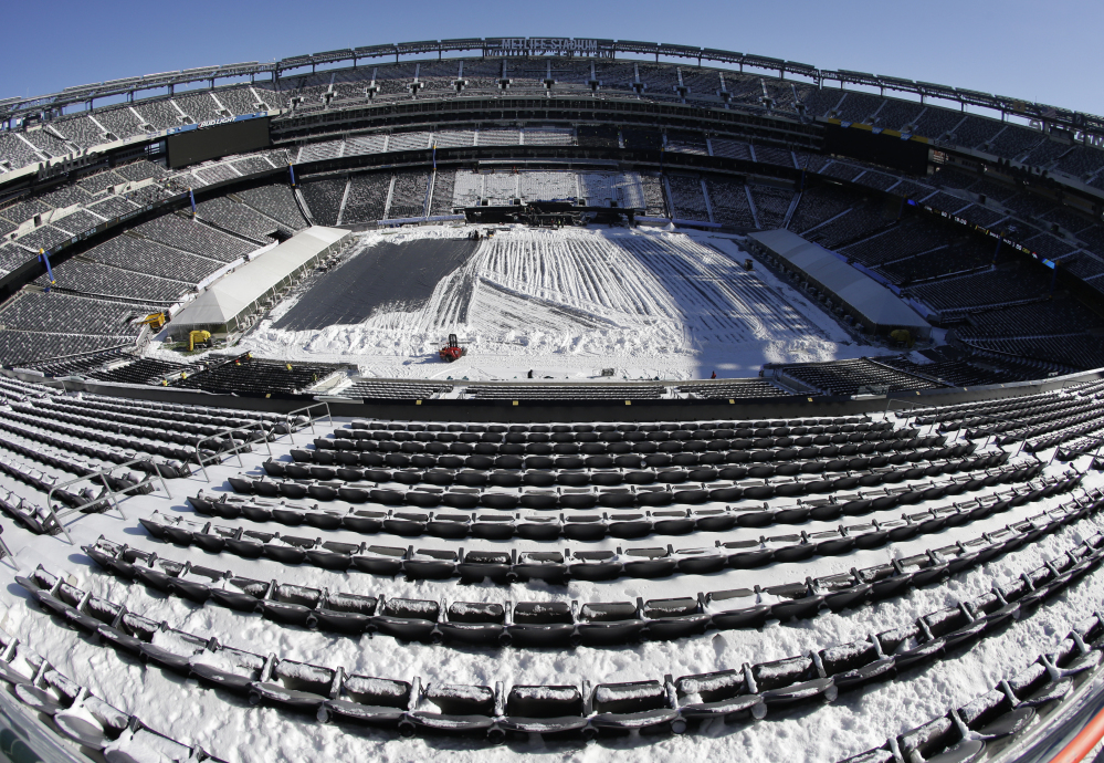 Snow is accumulated on the seats and on the field of MetLife Stadium as crews removed snow ahead of Super Bowl XLVIII following a snow storm last Wednesday. Super Bowl XLVIII, which will be played between the Denver Broncos and the Seattle Seahawks on Feb. 2, will be the first Super Bowl held outdoors in a city where it snows.