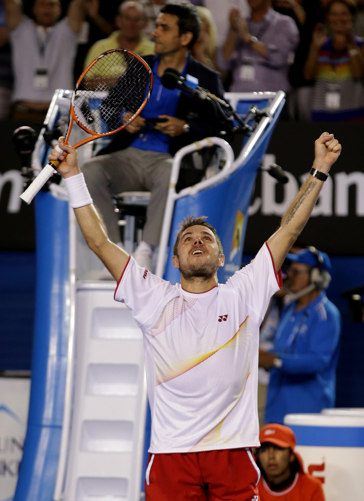 Stanislas Wawrinka of Switzerland celebrates after defeating Rafael Nadal of Spain during the men's singles final at the Australian Open tennis championship in Melbourne, Australia, Sunday, Jan. 26, 2014.(AP Photo/Aaron Favila)