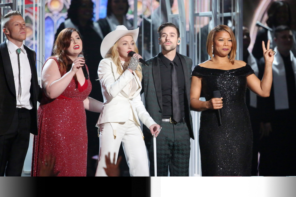 "Performers, from left, Macklemore, Mary Lambert, Madonna, Ryan Lewis and Queen Latifah appear on stage during a performance of ""Same Love"" at the 56th annual Grammy Awards at Staples Center on Sunday in Los Angeles."