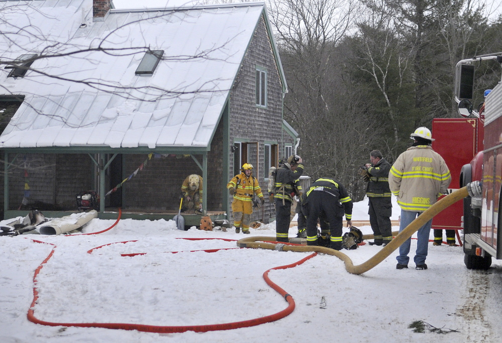 Staff photo by Andy Molloy SAVED: Firefighters prepare to enter a Jefferson home Monday where a fire damaged the interior. No injuries were reported.