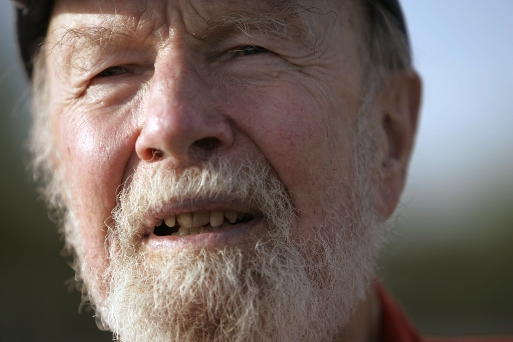 In this May 5, 2006 file photo, Pete Seeger talks during an interview in Beacon, N.Y. The banjo-picking troubadour who sang for migrant workers, college students and star-struck presidents in a career that introduced generations of Americans to their folk music heritage died Monday, Jan. 27, 2014 at the age of 94.