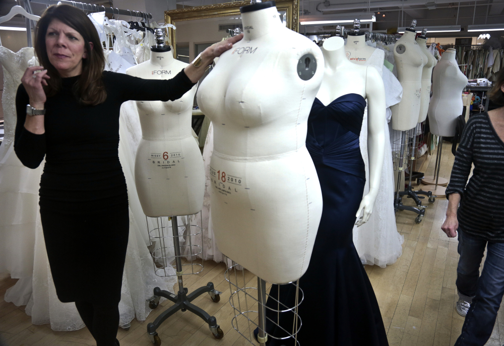 David's Bridal senior vice president Michele von Plato shows a plus-size mannequin in New York. David's Bridal, the nation's largest bridal chain, started changing its mannequins to reflect the average body.