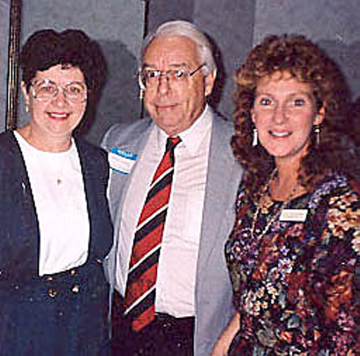TOGETHER: Walter Simcock is surrounded by former Mid-Maine Chamber of Commerce employees Audrey Harding, left, and Jill Van Gorden.