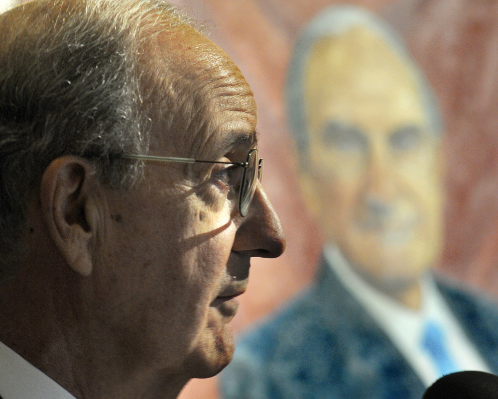 Staff photo by Andy Molloy ON DISPLAY: Former US Senator George Mitchell speaks Tuesday at the ceremony to unveil his official portrait at the Statehouse in Augusta.