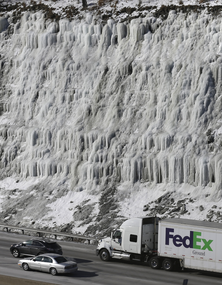 Traffic moves south on Interstate 75 past a hill covered with ice Wednesday in Covington, Ky., where temperatures remain in single digits. Temperatures will range from the teens in northern Kentucky to double-digits below zero in Minnesota, but even colder wind chills were expected: minus 43 in Minneapolis; minus 18 in Dayton, Ohio; minus 14 in Kansas City, Mo.; and minus 3 in Louisville, Ky.
