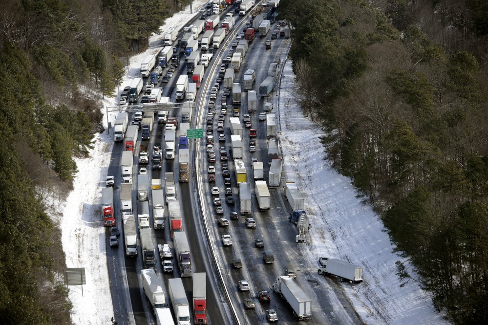 In this aerial photo, traffic is snarled along the Interstate 285 perimeter north of the metro area after a winter snowstorm Wednesday in Atlanta.