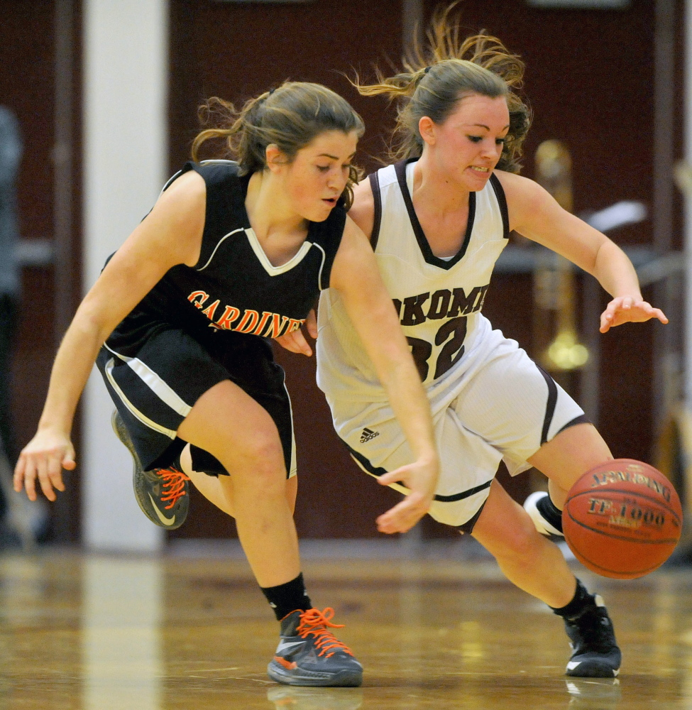 Staff photo by Michael G. Seamans Gardiner High School's Lauren Chadwick, 4, fights for the loose ball with Nokomis High School's Taylor Shaw, 32, in Newport on Wednesday.