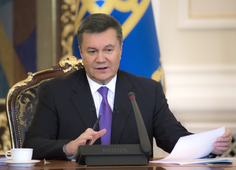 Ukrainian President Viktor Yanukovych holds a press conference in Kiev, recently. Protesters are demanding Yanukovych's resignation, early elections and the firing of authorities responsible for violent police dispersals of demonstrators.