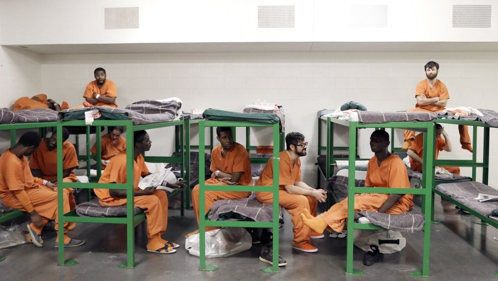 Inmates hang out on their bunks in a new unit in the Harris County Jail for gay, bisexual and transgender inmates in December in Houston, Texas.