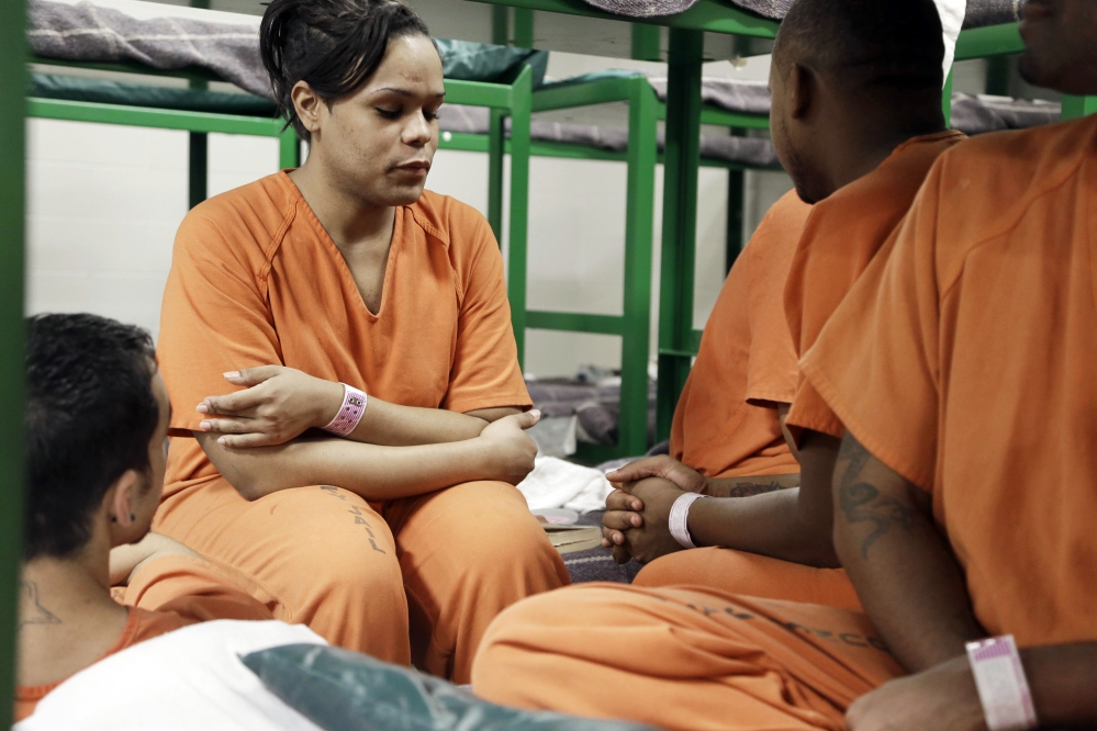 Tyniehsa Stephens sits with cellmates in a new unit in the Harris County Jail for gay, bisexual and transgender prisoners last December in Houston, Texas. Harris County is one of many jails around the country hoping to house inmates based on where they will be safest, and consider gender identity when making that decision.