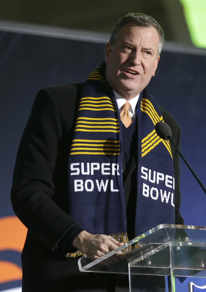 New York City Mayor Bill de Blasio speaks during a ceremony unveiling the Roman numerals for Super Bowl XLVIII on Super Bowl Boulevard on Wednesday in New York. On Thursday he announced plans for reforming police stop-and-frisk tactics.
