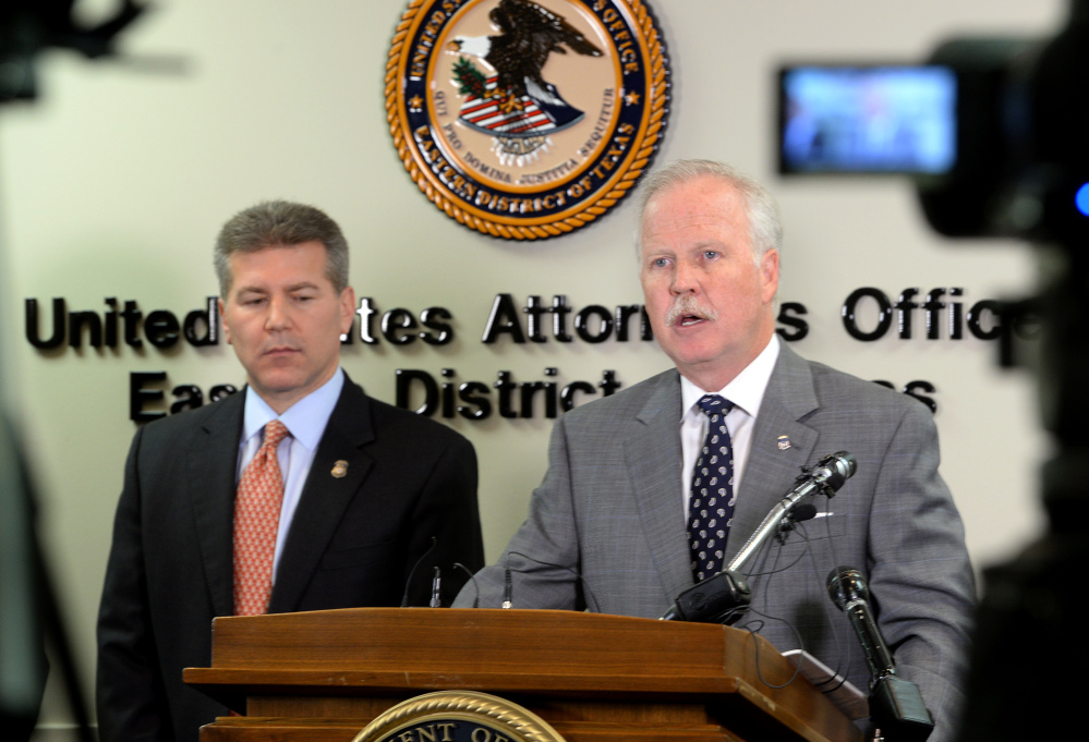 U.S. Attorney John M. Bales, right, and Brian Moskowitz with Homeland Security address media Thursday Jan. 30, 2014, after several raids in Port Arthur and Houston that allegedly involved a large operation of illegal employment in multiple states. Twenty three arrests have been made.