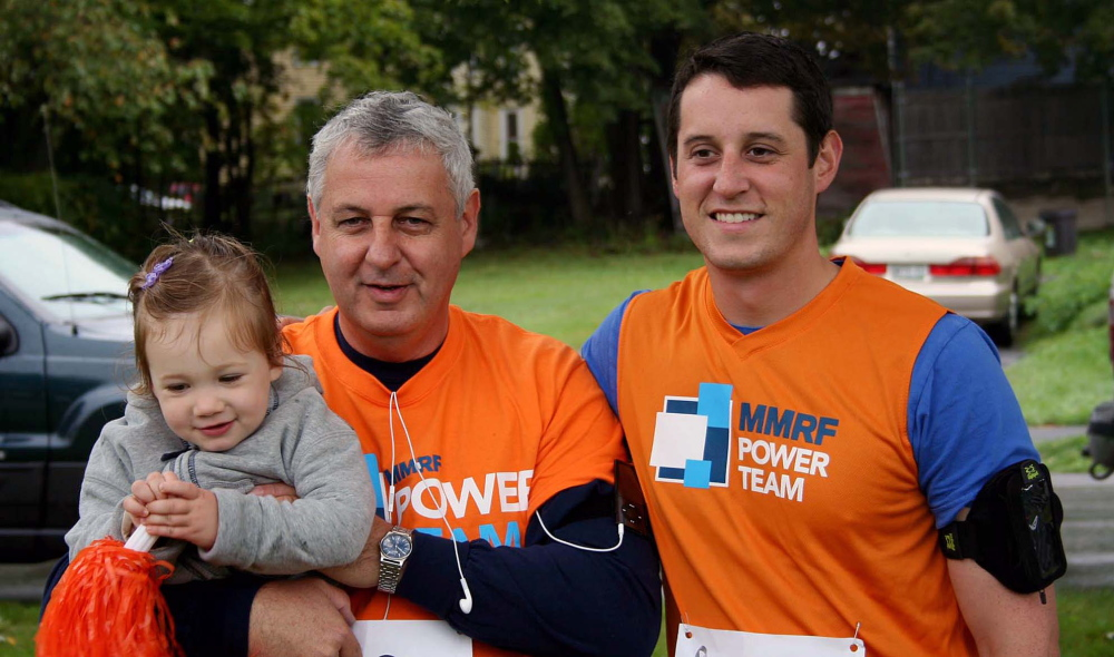 Contributed photoRUNNING TOGETHER: Michael Poulin, center, holds his granddaughter, Molly Magoun, next to his son and Molly's uncle, Nate Poulin, at 2012's Race for Myeloma 5K in Bangor. It was the first charity race that the Poulins ran. Nate, along with his sister and brother-in-law Katie and Andrew Magoun, would go on to raise more than $10,000 in 2013 for the Multiple Myeloma Research Foundation.