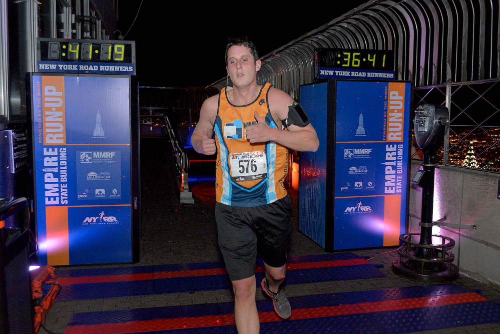 Contributed photoSTAIR MASTER: Nate Poulin runs in last year's Empire State Building Run-Up, the annual climb up the Empire State Building's 1,576 steps. Poulin will be running it again Wednesday to raise money for the Multiple Myeloma Research Foundation, after his father, Michael Poulin of Winslow, was diagnosed with the incurable cancer.