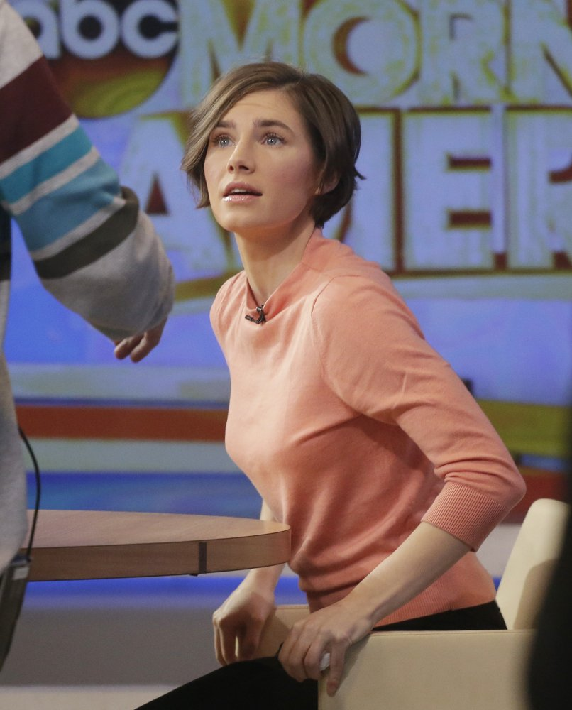 "Amanda Knox prepares to leave the set following a television interview with Robin Roberts on ABC's ""Good Morning America"" Friday."