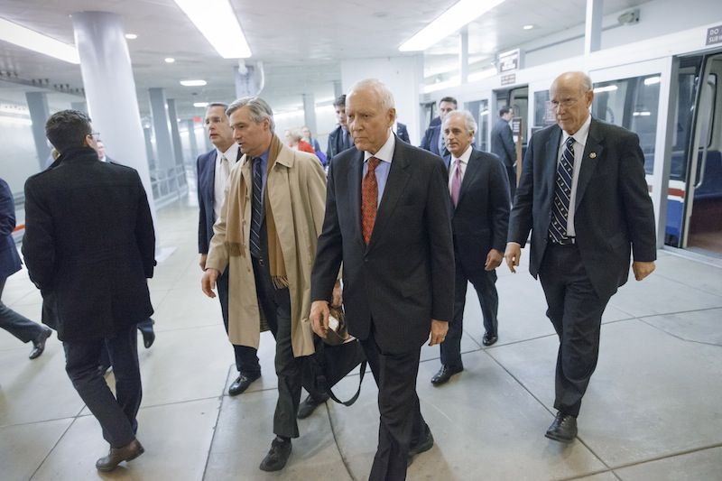 In this Jan. 16 file photo, Republican lawmakers arrive at the Capitol as the Senate votes to approve a $1.1 trillion spending package. Congress is revisiting its decision to cut annual cost-of living adjustments to pensions for most working-age military retirees after talk of the cuts drew outrage from veterans groups.