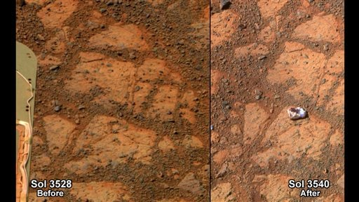 This composite image provided by NASA shows before and-after images taken by the Opportunity rover. At left is an image of a patch of ground taken on Dec. 26, 2013. At right is an image taken on Jan. 8, 2014, showing a rock shaped like a jelly doughnut that had not been there before. The space agency said the rover likely kicked up the rock into its field of view. Opportunity landed on Mars in 2004 and continues to explore.