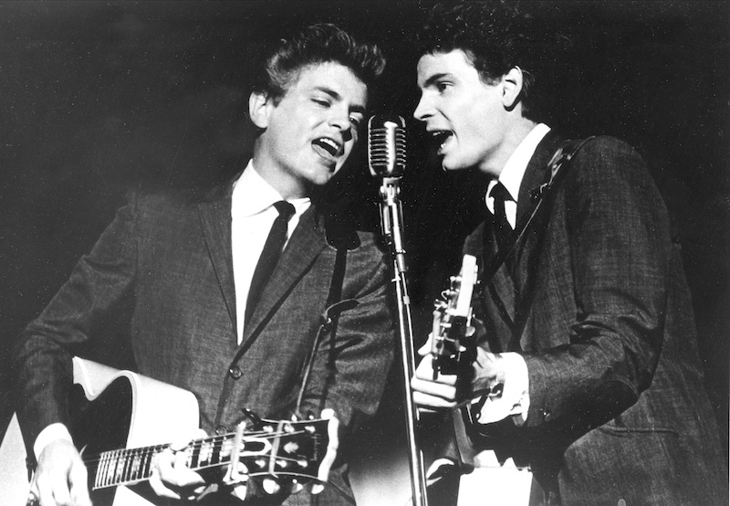 The Everly Brothers, Don and Phil, perform in 1964. Phil Everly, 74, died Friday of chronic obstructive pulmonary disease at a Burbank hospital, said his son Jason Everly.