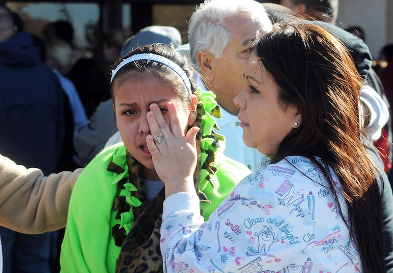Students are reunited with families at a staging ground set up at the Roswell Mall following an early morning shooting at Berrendo Middle School in Roswell, New Mexico, Tuesday, January 14, 2014.