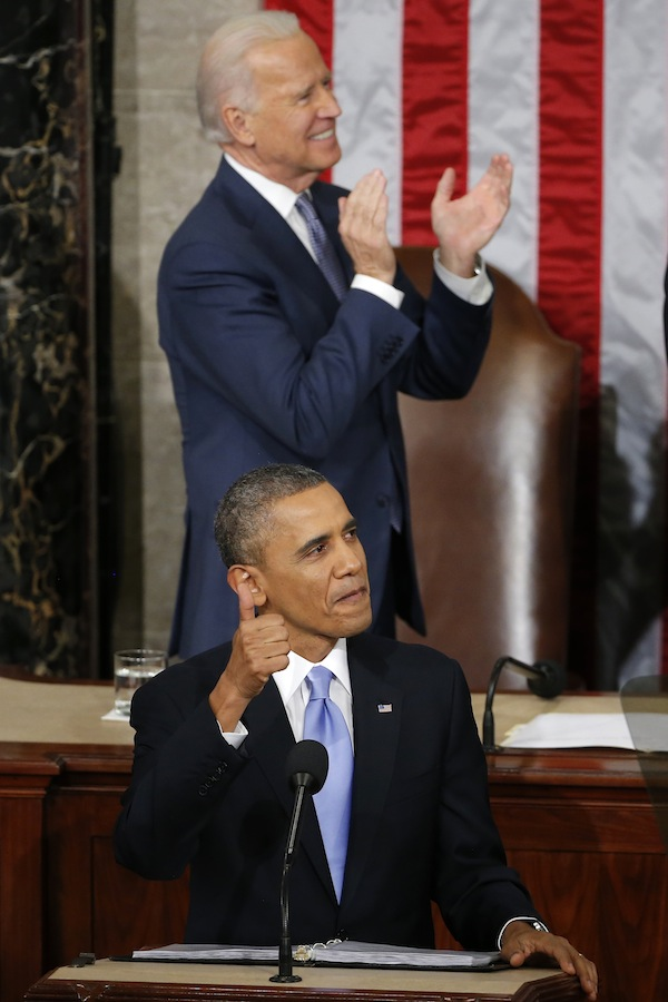 President Barack Obama gives a thumbs-up and Vice President Joe Biden applauds Army Ranger 1st Class Cory Remsburg during the president's State of the Union address on Capitol Hill in Washington, Tuesday Jan. 28, 2014.
