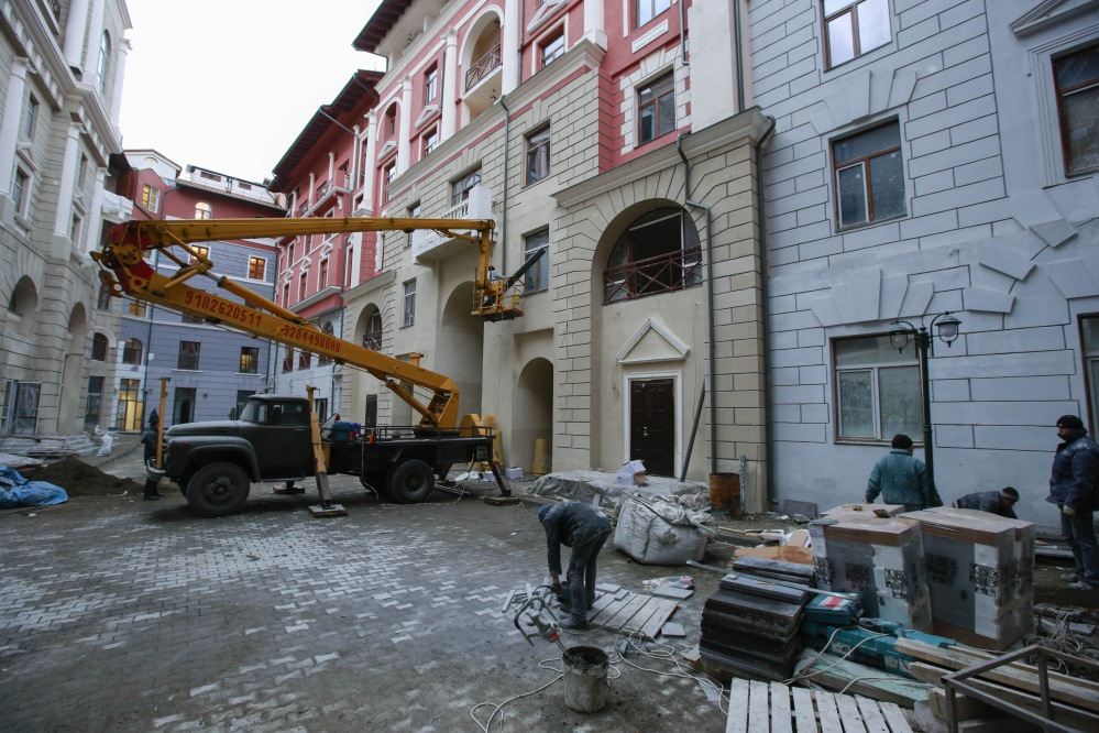 Workers put the finishing touch on accommodation for the Sochi 2014 Winter Olympics on Saturday in Krasnaya Polyana, Russia. According to the Sochi Olympic organizing committee, only six of the nine media hotels in the mountain area are fully operational. The accommodation for athletes, however, has not been affected.