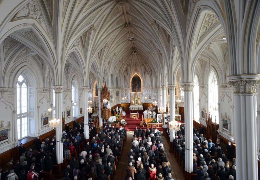 People attend a memorial service at the St. Jean Baptiste church in memory of the victims of last weeks seniors' residence fire on Saturday in L'Isle-Verte, Quebec.