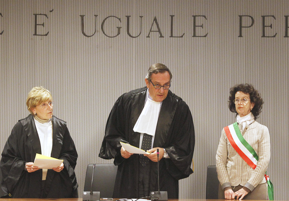 The Associated Press Appeals Court Judge Alessandro Nencini, center, reads out the verdict for the murder of British student Meredith Kercher, in Florence, Italy, Thursday.