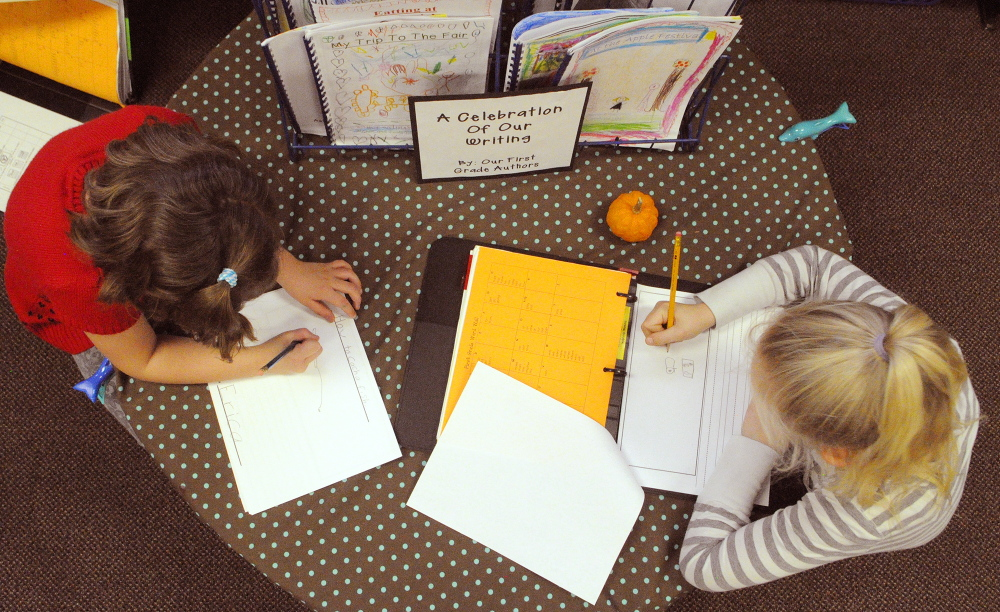 Erica Belz, left, and Faith DiFazio sketch as they start a story during a writing workshop last fall in Jessica Gurney's classroom at Manchester Elementary School.