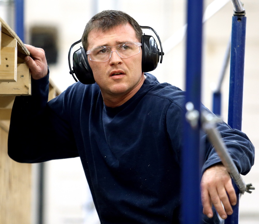 Press Herald photo by Gabe Souza LEARNING A TRADE: Travis Bentley works during a building construction class at Central Maine Community College in Auburn on Friday. Bentley is a graduate of Veterans Treatment Court.