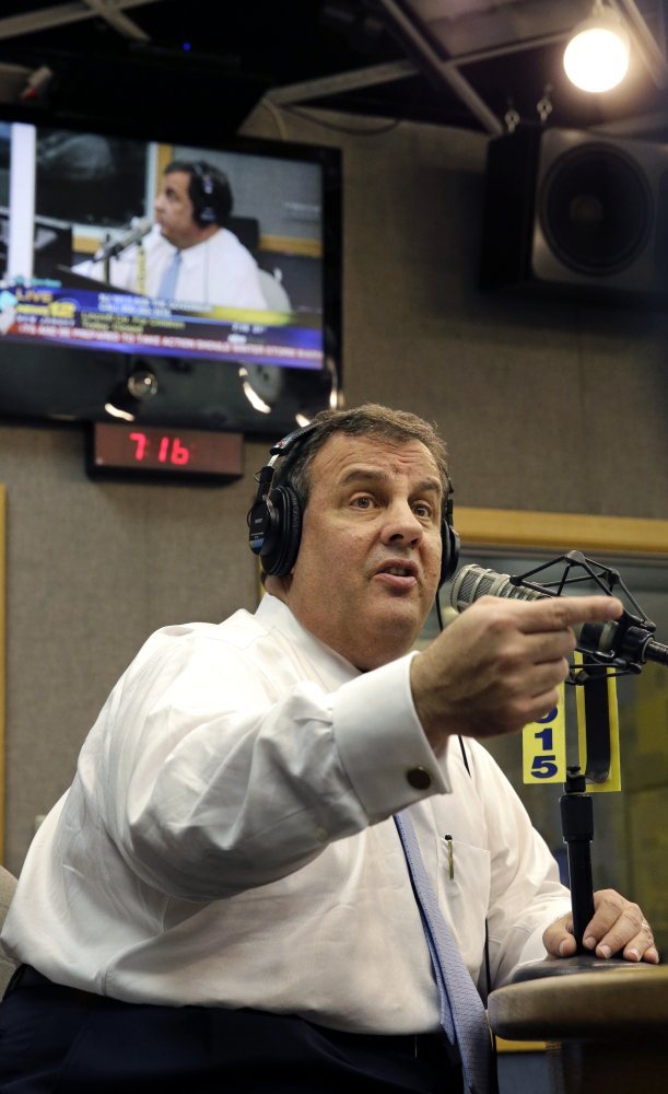 """New Jersey Gov. Chris Christie talks to a listener during an """"Ask the Governor"""" broadcast at a Ewing, N.J., radio station Monday. During the program, Christie took questions from callers for the first time in more than three weeks as his campaign looked for a way to pay for lawyers as a political payback scandal continues."""