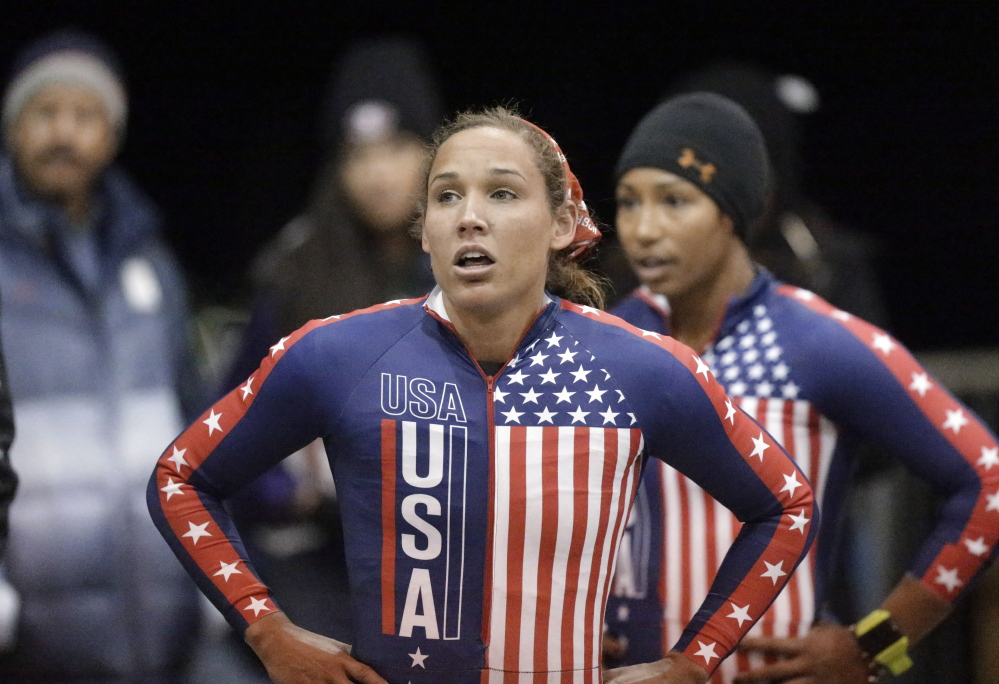 """In this Oct. 25, 2013, photo, Lolo Jones, foreground, and teammate Jazmine Fenlator look up after racing in the U.S. women's bobsled team Olympic trials in Park City, Utah. Jones has gotten ill at the Sochi Olympics. Jones tweeted Monday, Feb. 10, 2014, that she was in a """"quarantine room"""" in the village. U.S. bobsled spokeswoman Amanda Bird confirmed Jones exhibited cold and flu symptoms, and that the move was precautionary. (AP Photo/Rick Bowmer, File)"""