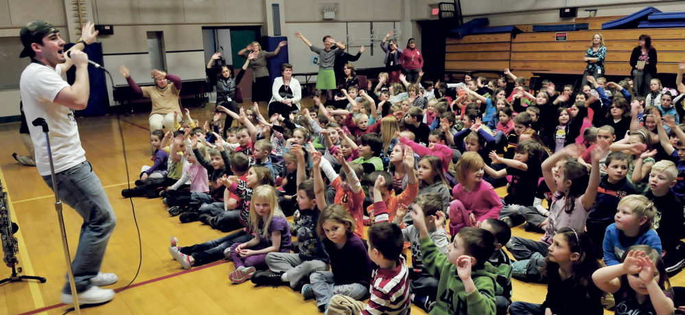 RHYME TiME: Hip-hop artist and Cape Cod Hill School alumnus Devin Ferreira entertains students and teachers at the New Sharon school on Monday.