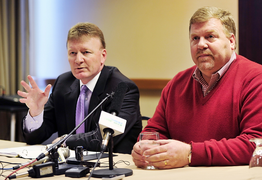 Neal Pratt, left, chair of the board of trustees of the Cumberland County Civic Center, and Ron Cain, majority owner of the Portland Pirates, announce the signing of a five-year contract Tuesday for the Pirates to play at the civic center.