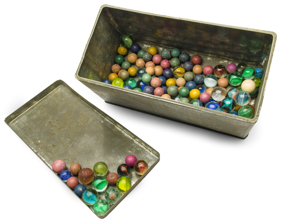 This Nov. 14, 2013 photo provided by the Anne Frank House Amsterdam on Tuesday, Feb. 4, 2014, shows a set of marbles belonging to Anne Frank.