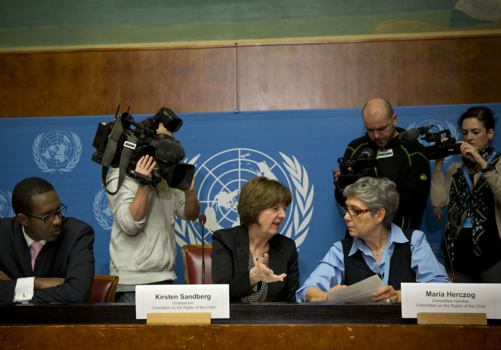 Kirsten Sandberg, center, chairperson of the U.N. Committee on the Rights of the Child, talks to committee members Maria Herczog, right, and Benyam Mezmur during a news conference at the United Nations headquarters in Geneva, Switzerland, on Wednesday. The committee denounced several Vatican policies.