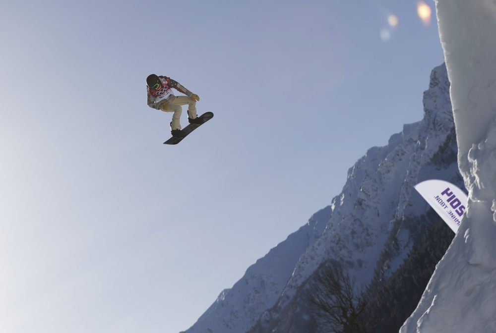 Shaun White of the United States takes a jump during a Snowboard Slopestyle training session at the Rosa Khutor Extreme Park in Krasnaya Polyana, Russia, prior to the 2014 Winter Olympics.