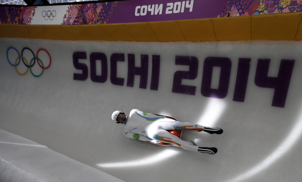 Shiva Keshavan, who is from India but competing under the Olympic Flag, completes a practice run in the men's luge singles at the 2014 Winter Olympics, Tuesday, Feb. 4, 2014, in Krasnaya Polyana, Russia. Keshavan is competing in his fifth Olympics and cannot represent India because his nation is under international sanctions. (AP Photo/Natacha Pisarenko)