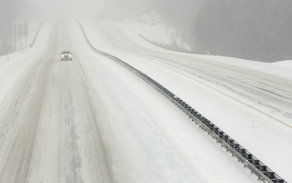 An SUV travels northbound on a deserted stretch of the Maine Turnpike in Kennebunk on Wednesday.