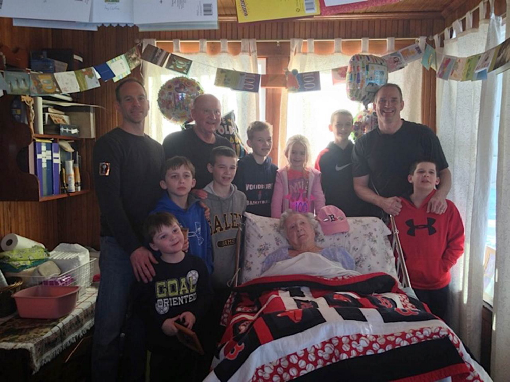 BIRTHDAY GIRL: Mary Burns, center, celebrates her 100th birthday with a son, grandsons and seven of her great-grandchildren at the Augusta home she shares with son Gary and daughter-in-law Carolyn.