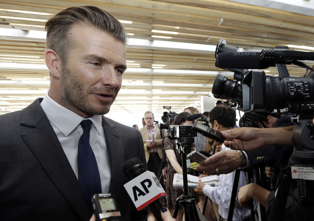 SOUTH BEACH SOCCER: Former England soccer star David Beckham responds to a question following a news conference where he announced Wednesday he will exercise his option to purchase a Major League Soccer expansion team in Miami.