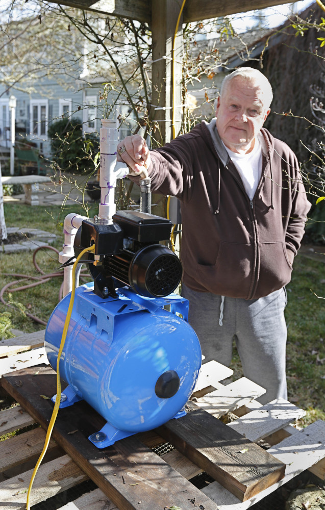 Charles Davison, a retired high school principal, installed a pump on an unused well to help supplement his household water supply in Willits, Calif.